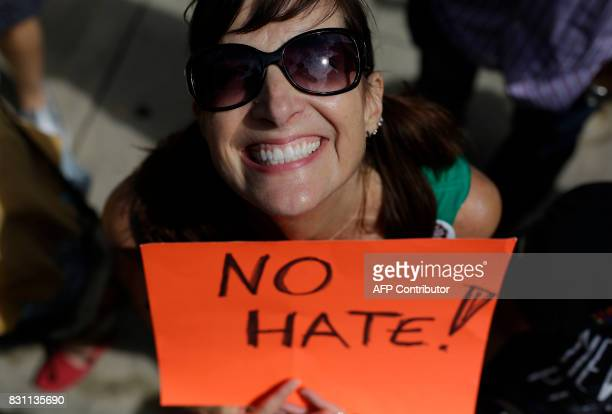 A demonstrator holds a sign during a protest against hate white supremacy groups and President Donald Trump on Sunday August 13 2017 in Chicago...
