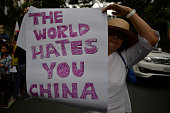 A demonstrator holds a sign during a protest outside the Chinese consulate in Makati Metro Manila Philippines June 12 2014 Demonstrators marked...