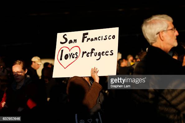 A demonstrator holds a sign during a rally against muslim immigration ban at San Francisco International Airport on January 28 2017 in San Francisco...