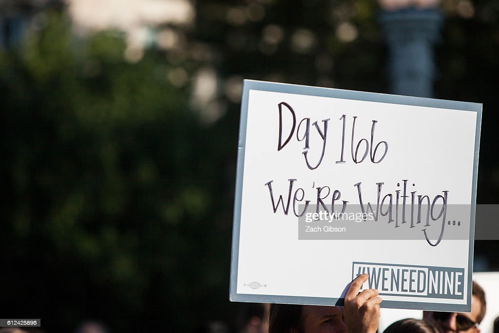 A demonstrator holds a sign during a rally urging the U.S. Senate to hold a confirmation vote for Supreme Court Nominee Merrick Garland outside of The Supreme Court of the United States on October 4, 2016 in Washington, DC. Today marks the 202nd day since President Barack Obama nominated Judge Garland to fill the vacancy left after former Justice Antonin Scalia passed away in February.