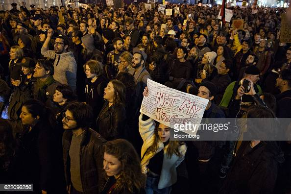 A demonstrator holds a sign reading 'Not My President' during a rally against US Presidentelect Donald Trump at Union Square in New York US on...