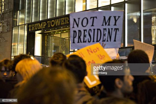 A demonstrator holds a sign reading 'Not My President' outside Trump Tower during a rally against US Presidentelect Donald Trump in New York US on...