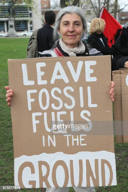 Demonstrator holds a sign saying 'leave fossil fuels in the ground' as hundreds of Canadians took part in a massive march against climate change...