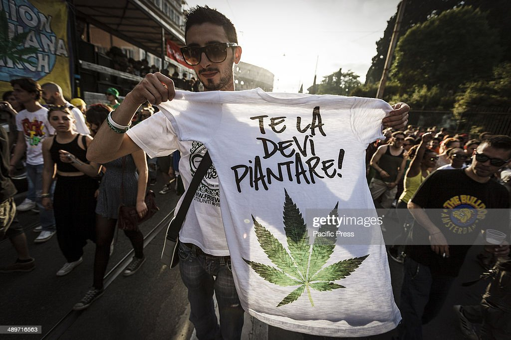 Demonstrator holds a t-shirt painted with marijuana leaves during the Global Marijuana March in Rome to ask for the legalization of marijuana on Saturday. Thousands of people marched downtown in Rome during the Global Marijuana March, an annual rally held at different locations across the planet, demanding the legalization of marijuana and changes in drug policies. The Global Marijuana March (GMM) also goes by the name of the Worldwide Marijuana March (WMM) or Million Marijuana March (MMM).