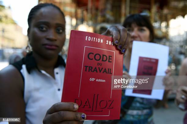 A demonstrator holds an edition of France's labor code during a demonstration organised by 'La France Insoumise' leftist party against the French...