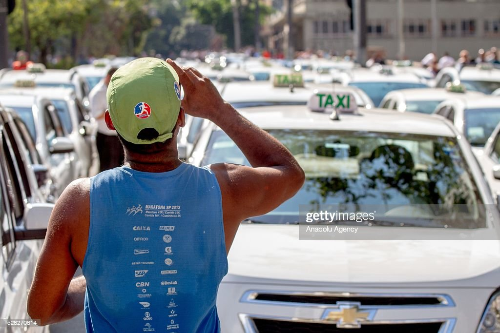 Demonstrator Hundreds of taxi drivers attend a demonstration against the bill of approval regulating taxi service applications such as UBER in Sao Paulo, Brazil on May 04, 2016.