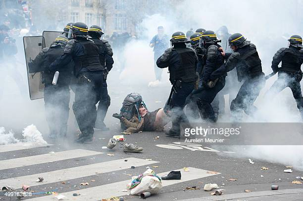 A demonstrator is arrested by the riot police during the forbidden COP21 demonstration on November 29 2015 in Paris France The demonstration was...