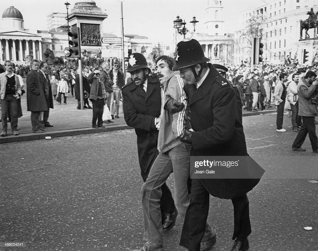 A demonstrator is arrested during a rally attended by fifteen thousand people in support of the 198485 Miner's Strike Trafalgar Square London 24th...