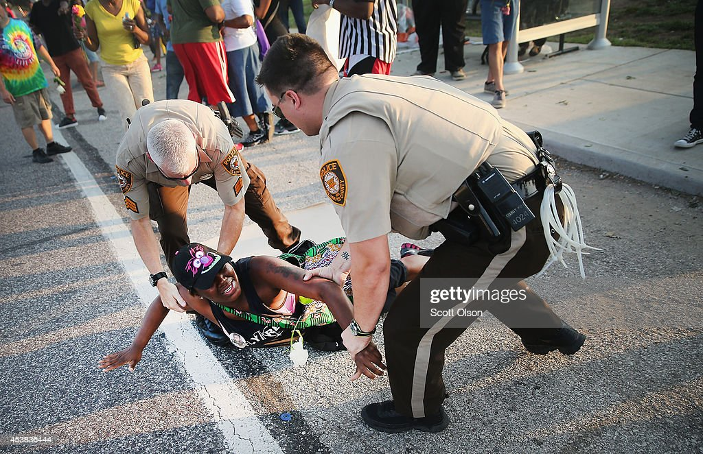 A demonstrator is arrested while protesting the killing of teenager Michael Brown on August 19, 2014 in Ferguson, Missouri. Brown was shot and killed by a Ferguson police officer on August 9. Despite the Brown family's continued call for peaceful demonstrations, violent protests have erupted nearly every night in Ferguson since his death.