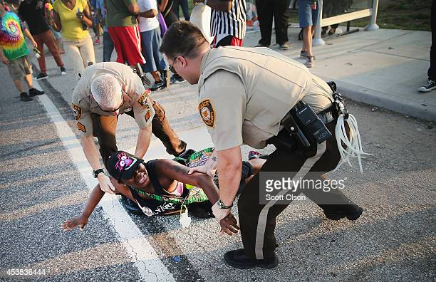 A demonstrator is arrested while protesting the killing of teenager Michael Brown on August 19 2014 in Ferguson Missouri Brown was shot and killed by...
