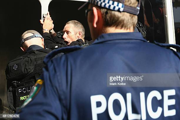 A demonstrator is detained by police after a disturbance as the 'Reclaim Australia' rally and counter rally as protesters gather in Martin Place on...