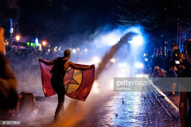 A demonstrator is hit by a water gun in Hamburg Germany on July 6 2017 The police stopped the leftradical demonstration quotG20 Welcome to Hellquot...