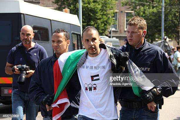A demonstrator is taken into custody during antiIsrael protests in Lahey Netherlands on 5 August 2014 Demonstrators gather in front of Embassy of...