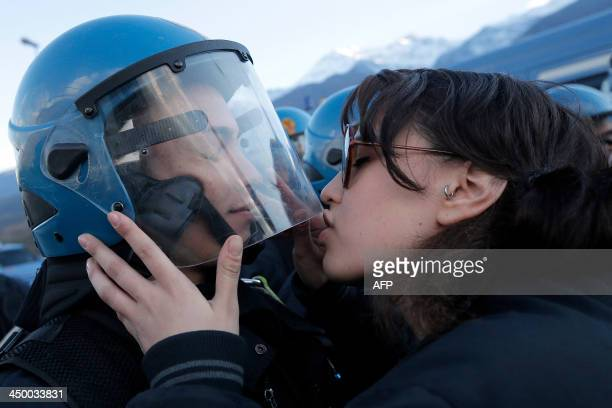 A demonstrator kisses a riot police officer on November 16 2013 during a protest in Susa against the highspeed train line between Lyon and Turin The...