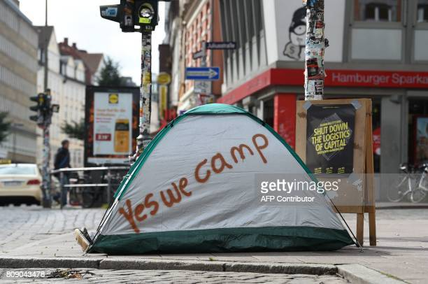 A demonstrator lays in a tent lettered with the inscription 'Yes We Camp' on July 5 2017 on a street in Hamburg northern Germany where leaders of the...