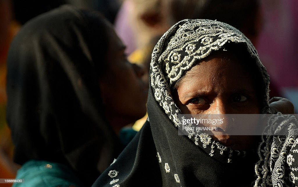 A demonstrator looks on during a protest rally by slum dwellers in Mumbai on January 2, 2013. Around two thousand slum dwellers took part in the protest to demand housing rights for the poor from the government.