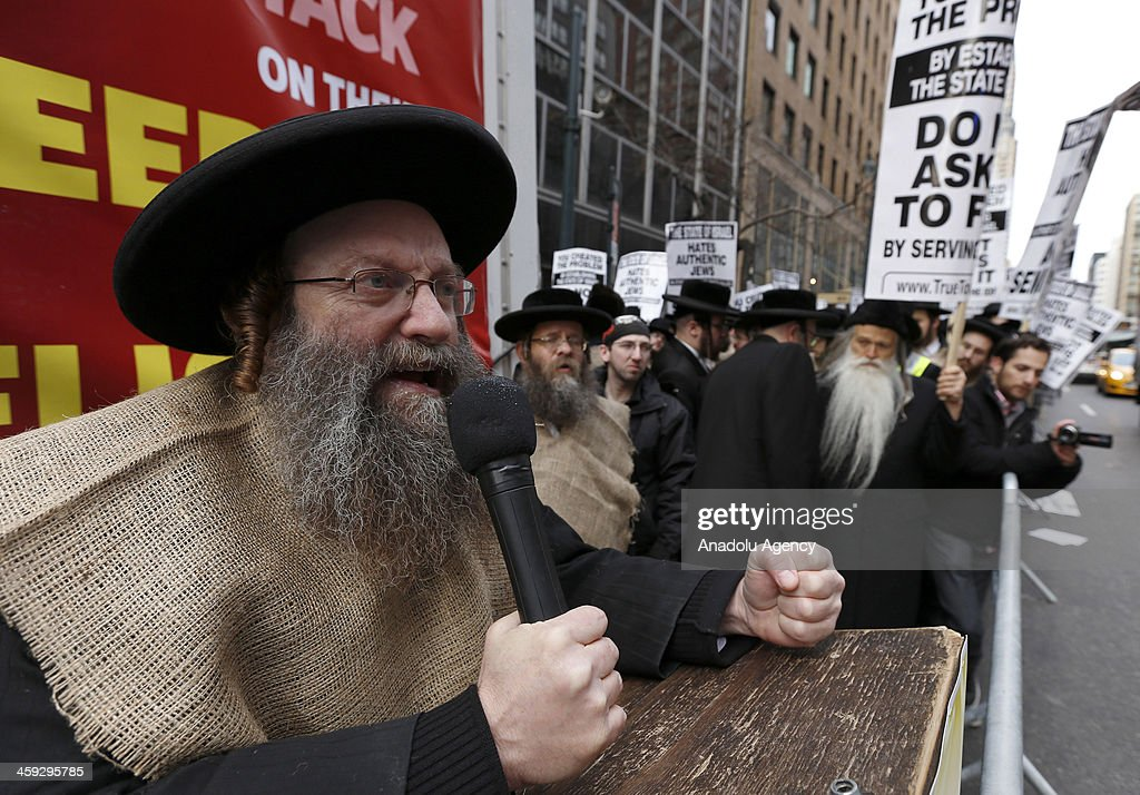A demonstrator makes a speech during a protest in New York City on December 24 2013 Hundreds of Orthodox Jewish students marched to the Israeli...