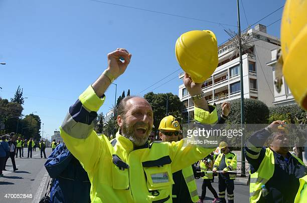 A demonstrator makes noise with his hardhat in protestEmployees of Hellas Gold company organised a demonstration in Athens in support of the...