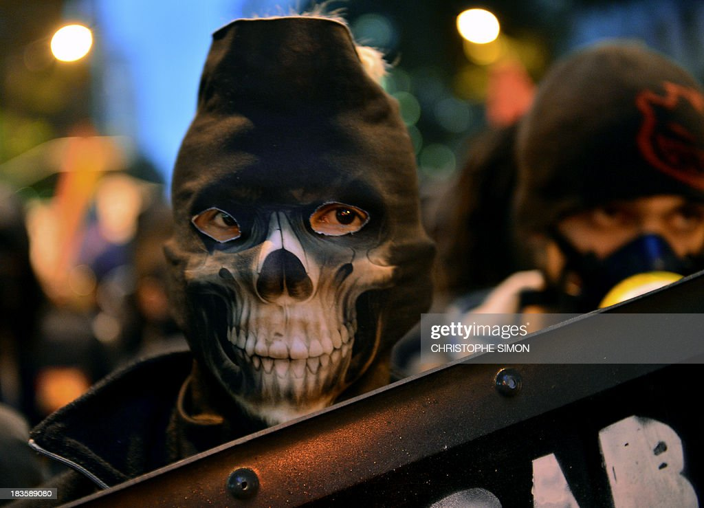 A demonstrator marches during a teachers protest demanding better working conditions and against police beating, on October 7, 2013 in Rio de Janeiro.