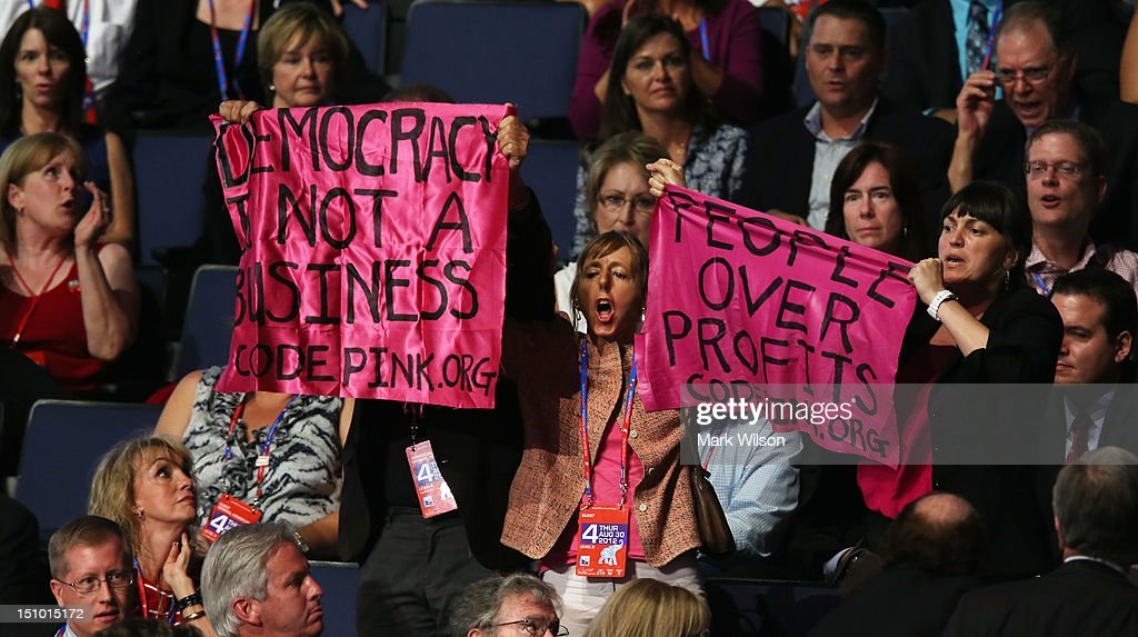 Demonstrator Medea Benjamin of Code Pink yells from the stands during the final day of the Republican National Convention at the Tampa Bay Times...