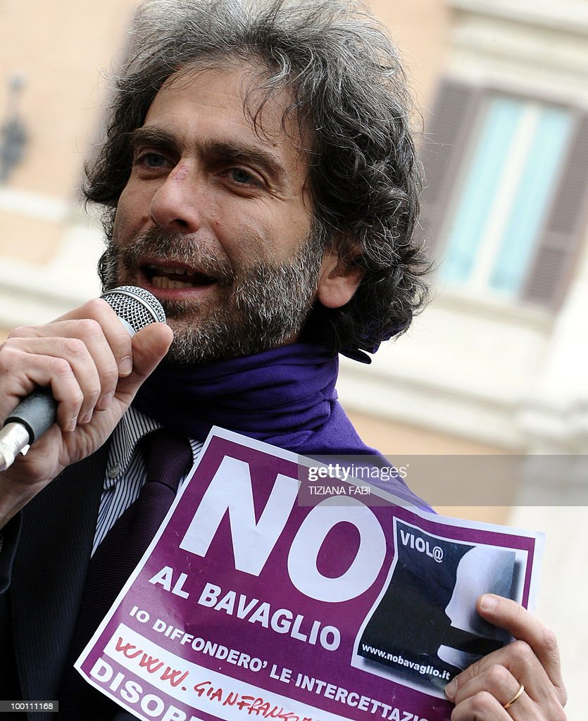 A demonstrator of the people in purple (Popolo Viola) rallies as he holds a sign reading 'no to the muzzling law' during a protest in central Rome on May 21, 2010 against the government's policy on phone tapping.