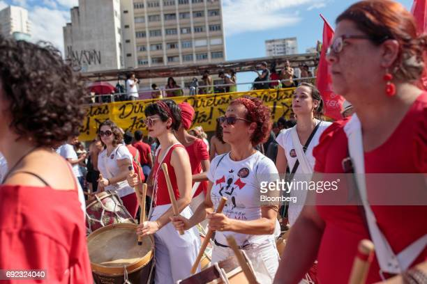 Demonstrator play drums during a protest against Brazilian President Michel Temer and government corruption at Largo da Batata in Sao Paulo Brazil on...