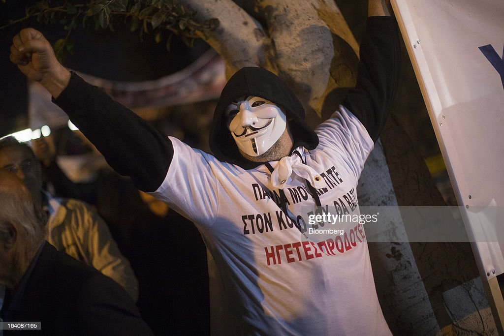 A demonstrator protests against bank deposit tax plans outside the parliament in Nicosia, Cyprus, on Tuesday, March 19, 2013. Cyprus's parliament rejected an unprecedented levy on bank deposits, dealing a blow to European plans to force depositors to shoulder part of the country's rescue in a standoff that risks renewed tumult in the euro area. Photographer: Simon Dawson/Bloomberg via Getty Images
