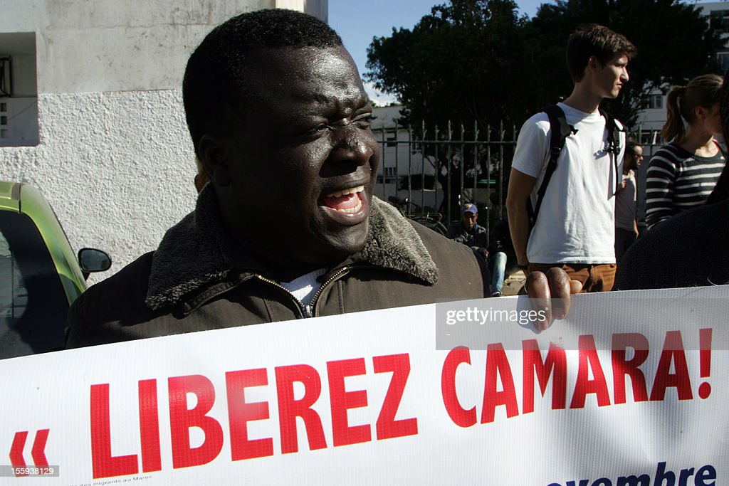 A demonstrator protests outside the court in Rabat on November 9, 2012, against the trial of Camara Laye, Head of the Council of Subsaharian Migrants in Morocco (CMSM), who was arrested for allegedly trafficking alcohol and cigarettes illegally. Laye, whose detention has been condemned by dozens of non-governmental organisations (NGOs), was released on bail after his hearing.