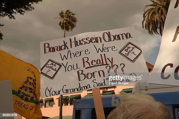 A demonstrator questions the citizenship of President Obama at an American Family Association sponsored TEA Party to protest taxes and economic...