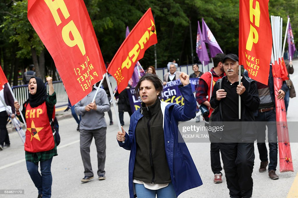 Demonstrator shout slogans and gesture during an anti-government, pro-secularism protest by Turkish worker unions on May 28, 2016 in Ankara. Turkish President Recep Tayyip Erdogan on May 22 gave his close ally and Transport Minister Binali Yildirim the mandate to form a government as prime minister in a move set to further consolidate the strongman's grip on power. Yildirim is only the third party chairman in the history of the AKP -- which has transformed Turkey by putting Islam at the forefront of the officially secular country's politics -- after Erdogan and Davutoglu. / AFP / ADEM