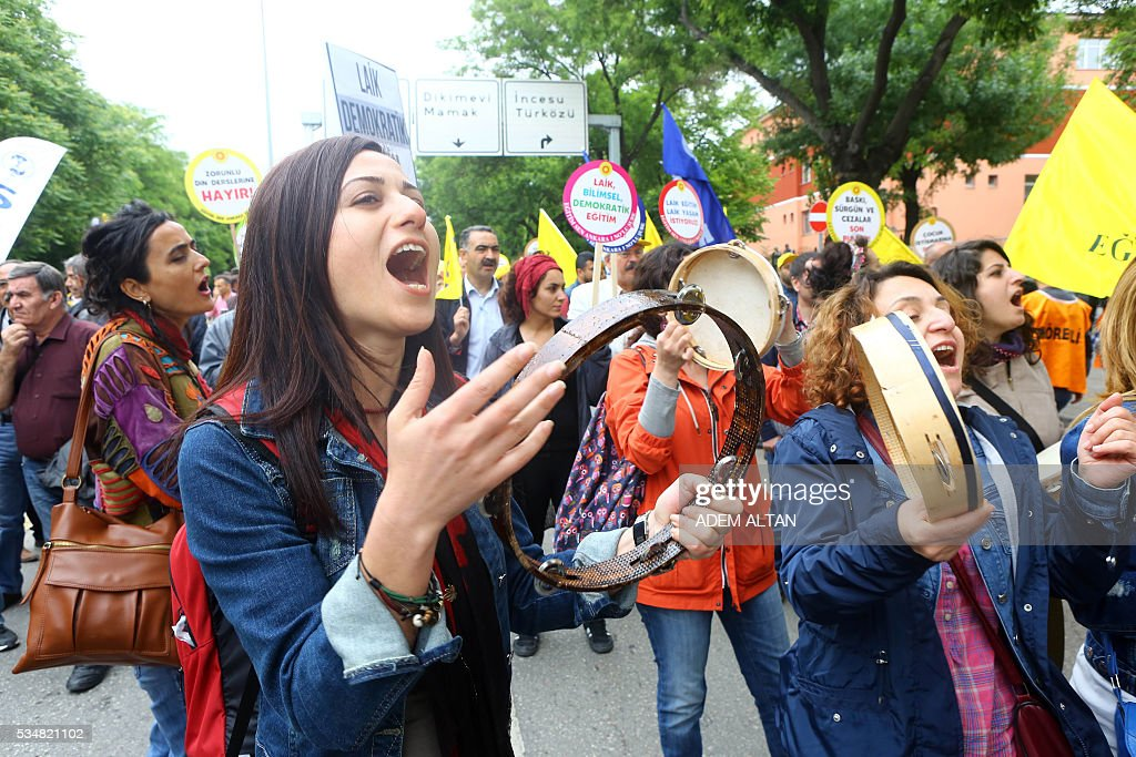 Demonstrator shout slogans during an anti-government, pro-secularism protest by Turkish worker unions on May 28, 2016 in Ankara. Turkish President Recep Tayyip Erdogan on May 22 gave his close ally and Transport Minister Binali Yildirim the mandate to form a government as prime minister in a move set to further consolidate the strongman's grip on power. Yildirim is only the third party chairman in the history of the AKP -- which has transformed Turkey by putting Islam at the forefront of the officially secular country's politics -- after Erdogan and Davutoglu. / AFP / ADEM