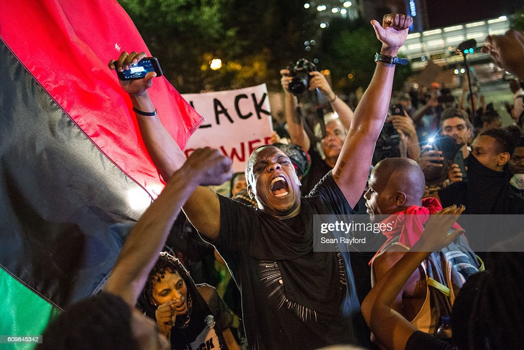 A demonstrator shouts during protests September 22, 2016 in Charlotte, North Carolina. Protests began on Tuesday night following the fatal shooting of 43-year-old Keith Lamont Scott at an apartment complex near UNC Charlotte. A state of emergency was declared overnight in Charlotte and a midnight curfew was imposed by mayor Jennifer Roberts, to be lifted at 6 a.m.