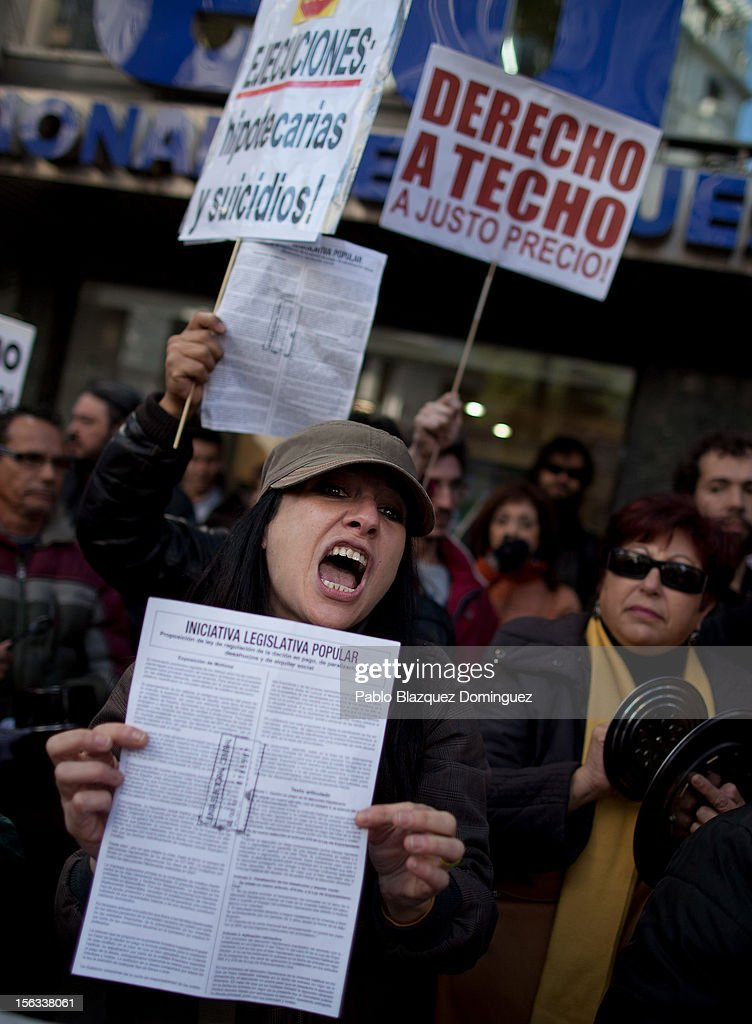 A demonstrator shouts slogans during a protest against evictions outside the PP (Popular Party) headquarters on November 12, 2012 in Madrid, Spain. Right placard reads 'Right to home at a fair price'. Spain's banks announced today that for the next two years they will suspend mortgage-related evictions of the most vulnerable people. The Spanish Banking Association (AEB) reacted three days after a woman in Barakaldo took her life just before she was due to be evicted from her home. A male homeowner facing eviction in Grenada committed suicide fifteen days earlier. There have been around 350,000 house evictions since Spain's property market crashed in 2008. The Platform for Mortgage Victims organisation has been preventing some evictions by blocking access to houses under threat of repossession.