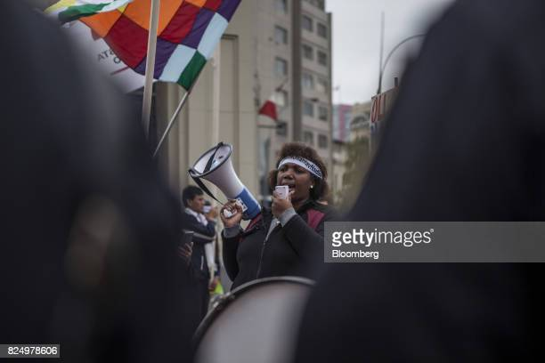 A demonstrator shouts slogans during a protest against the detention of former Peruvian President Ollanta Humala and his wife Nadine Heredia outside...