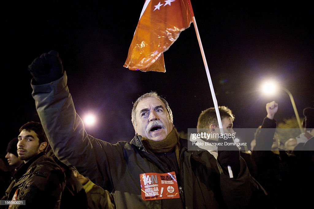A demonstrator shouts slogans during a protest in Carabanchel Bus Garages on November 14, 2012 in Madrid, Spain. A coordinated general strike by unions in Spain and Portugal has paralysed public transport in the two countries with further strikes planned across Europe. The strike against the governments' austerity measures have force hundreds of flights to be cancelled and factories and ports to come to a standstill.