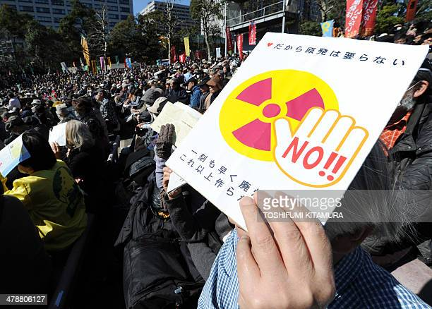 A demonstrator shows a 'No nuclear' placard during an antinuclear power plant rally in Tokyo on March 15 2014 About 5500 protesters participated in...