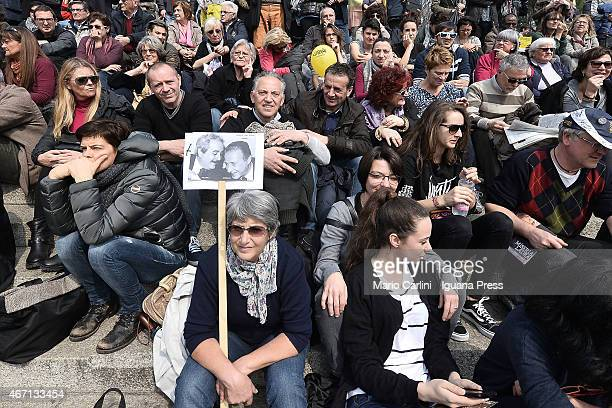 A demonstrator shows a panel with a picture of judges Giovanni Falcone and Paolo Borsellino during a march with 200000 participants for the 20th...