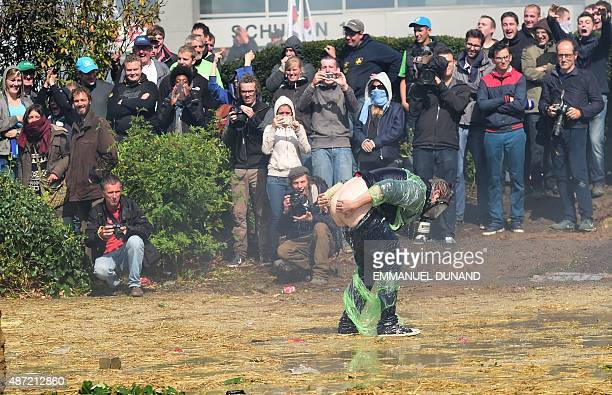 A demonstrator shows his bottom to antiriot policemen during a demonstration of farmers in front of the European Commission building on September 7...