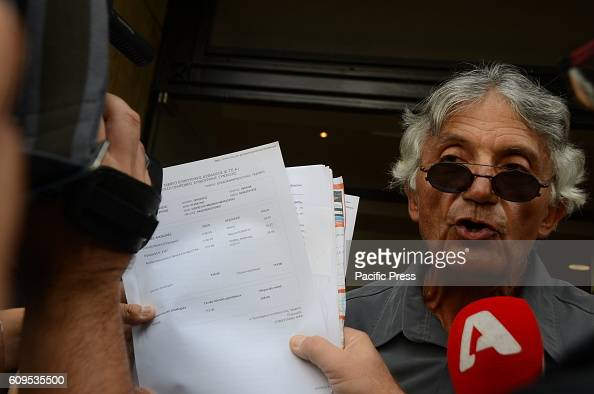 A demonstrator shows the results of the austerity measures in his pension and his benefits Greek retirees and private sector employees demonstrate in...