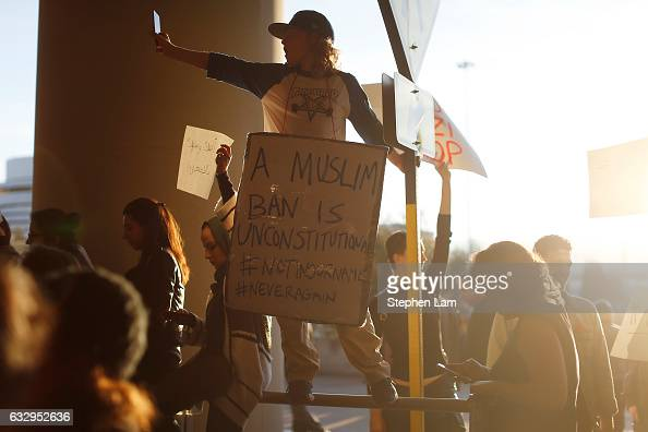 A demonstrator takes a photograph during a rally against muslim immigration ban at San Francisco International Airport on January 28 2017 in San...
