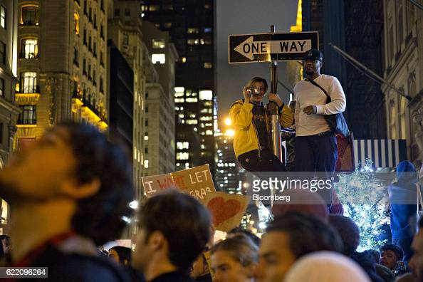 A demonstrator takes a photograph outside Trump Tower during a rally against US Presidentelect Donald Trump in New York US on Wednesday Nov 9 2016 In...