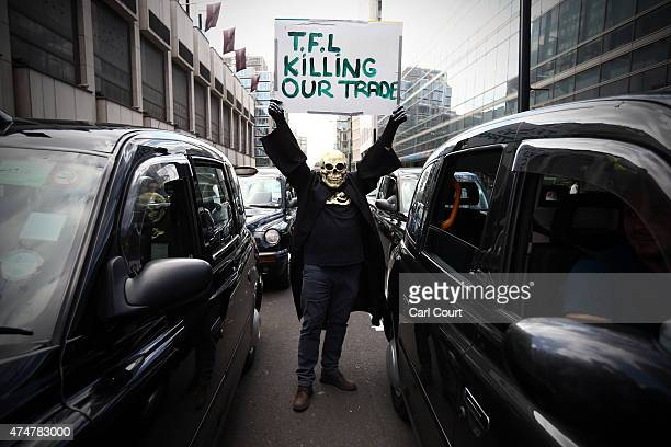 A demonstrator takes part in a London black cab protest against Transport for London on May 26 2015 in London England The demonstration organised by...