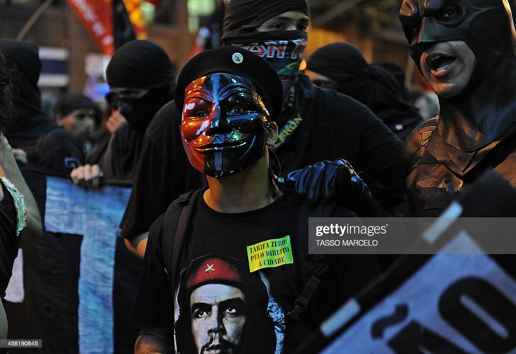 A demonstrator takes part in a protest against a public transport fare hike announced for January 2014 by Rio de Janeiro's Mayor Eduardo Paes, in the streets of the Brazilian city, on December 20, 2013.