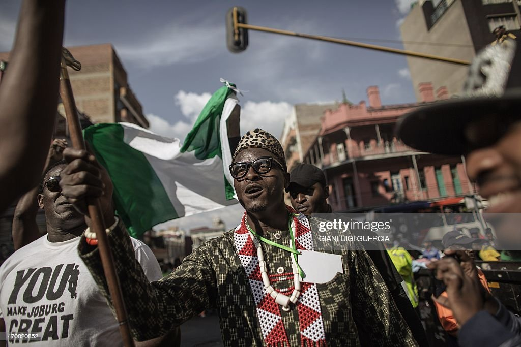 A demonstrator walks in Johannesburg on April 23 2015 during a march gathering several thousands of people to protest against the recent wave of...
