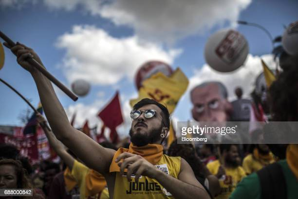 A demonstrator waves a flag during protests outside of the National Congress demanding the resignation of President Michel Temer in Brasilia Brazil...