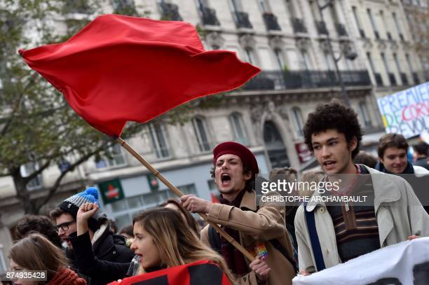 A demonstrator waves a red flag during a demonstration as part of a nationwide protest day against the government's economic and social reforms on...