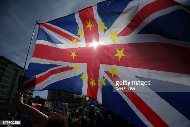 A demonstrator waves a Union flag decorated with the stars of the EU flag as they prepare to participate in an anti Brexit proEuropean Union march in...