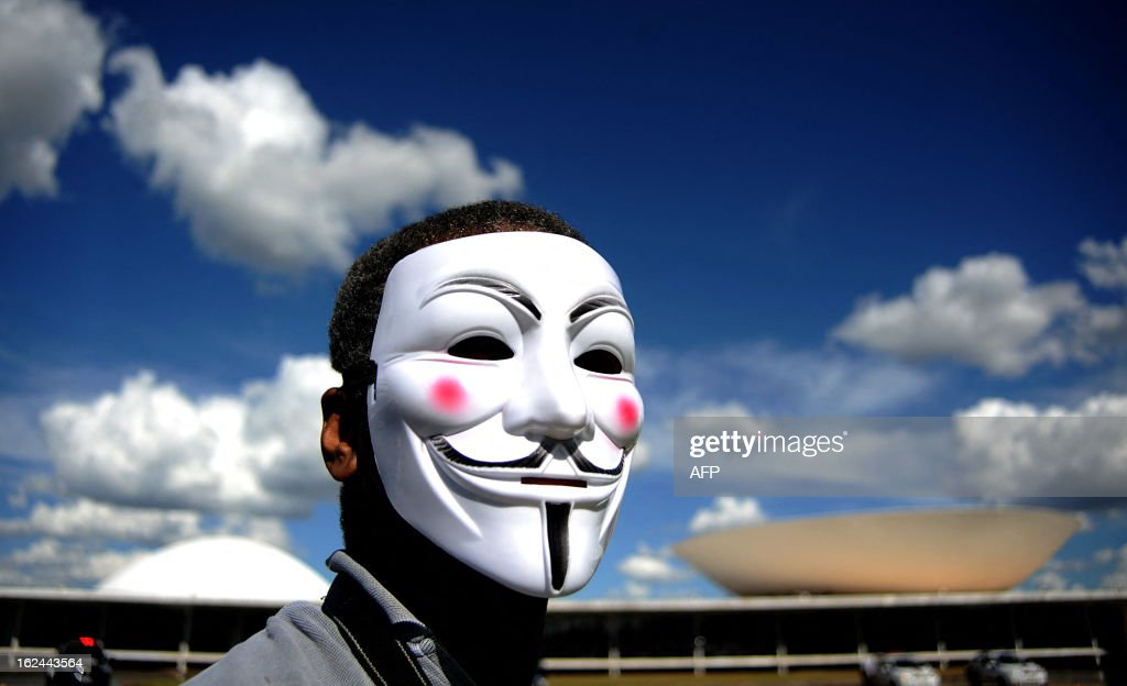 A demonstrator wearing a Guy Fawkes mask takes part in a protest against the president of the Brazilian Senate, Renan Calheiros, in front of the Brazilian National Congress, in Brasilia, on February 23, 2013. Calheiros was elected by his colleagues despite many corruption claims over him. An undersigned made on the internet with over then 1,5 million signatures was delivered by activists to the Senate this week, demanding his impeachment.
