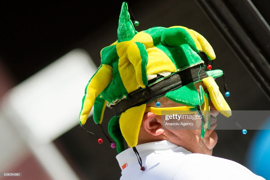 Demonstrator wearing a hat colored Brazilian National flag as hundreds of taxi drivers attend a demonstration against the bill of approval regulating taxi service applications such as UBER in Sao Paulo, Brazil on May 04, 2016.