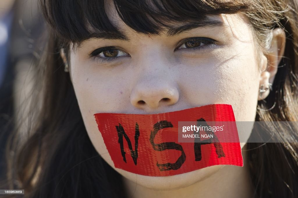 A demonstrator wearing tape over her mouth takes part in a protest against government surveillance on October 26, 2013 in Washington, DC. AFP PHOTO/Mandel NGAN